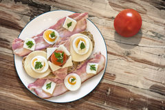 Plate with Bacon Cheese Egg Ham and Tomato Sandwich on Old Woode Stock Image