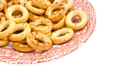 Plate of bagels. Pink plate of bagels on white background closeup Royalty Free Stock Images