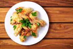 Plate with baked chicken wings and parsley Royalty Free Stock Images