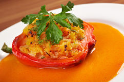 Plate with baked stuffed peppers. Stock Photos
