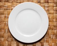 Plate on bamboo pad Royalty Free Stock Photos