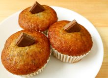 A Plate of Banana Muffins with Milk Chocolate Chunks Served on Wooden Table royalty free stock photos