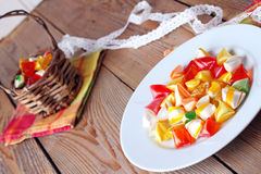 Plate and basket with colorful sweet candies. Selective focus. Traditional Seker Bayram holidays candies stock photo