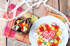 Plate and basket with colorful sweet candies. Selective focus. Traditional Seker Bayram holidays candies stock images