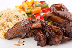 Plate of BBQ Sticky Ribs. Plate of Tasty BBQ Barbequed Spare Sticky Pork Ribs Stock Photography