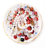 Plate with beads Stock Photography