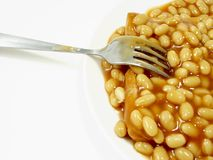 Plate of beans. With fork stock image