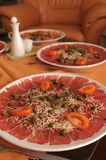Plate of beef carpaccio Royalty Free Stock Image