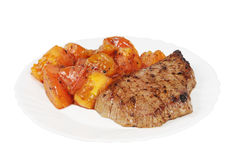 Plate with a beef steak and roasted Royalty Free Stock Photos