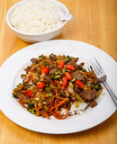 Plate of Beef Stir-fry and Bowl of Rice Stock Images