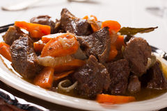 Plate of beef stroganoff with carrot Stock Images