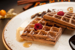 Plate of belgian waffles with caramel sauce and fresh berries Stock Photos