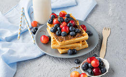 Plate of belgian waffles with chocolate and berries Stock Photo