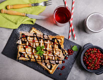 Plate of belgian waffles with chocolate sauce and currant fruit Stock Photo