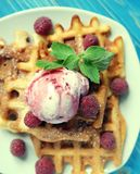 Plate of belgian waffles with ice cream and fresh berries over blue wooden background. Plate of belgian waffles with ice cream  and fresh berries over blue Stock Image