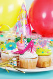 Plate of birthday cupcakes. With hats and balloons Stock Photography