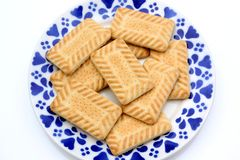 Plate of biscuits. A blue patterned plate with shortbread biscuits Royalty Free Stock Photos