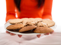 Plate of biscuits in hands Royalty Free Stock Photos