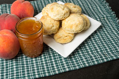 Plate of biscuits with peaches and jelly Stock Images