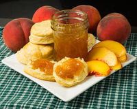 Plate of biscuits with peaches and peach jam Stock Images