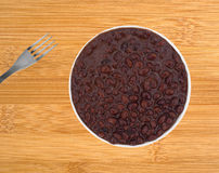 Plate of black beans in a chili sauce with fork Royalty Free Stock Images