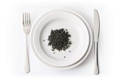 Plate with black caviar Stock Photos
