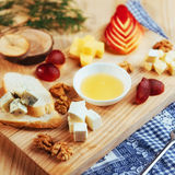 Plate with blue cheese Dor, parmesan, Brie Stock Photo