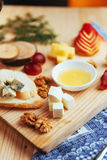 Plate with blue cheese Dor, parmesan, Brie Royalty Free Stock Photo