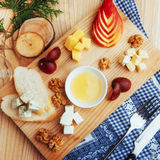 Plate with blue, Dor, parmesan cheese, Brie, Camemb Royalty Free Stock Photography