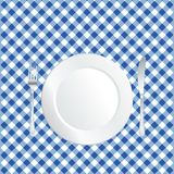 Plate on blue tablecloth Stock Photos
