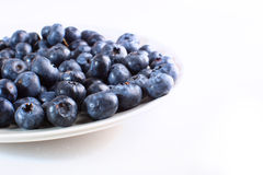 Plate with blueberries close-up isolated Royalty Free Stock Image