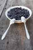 Plate of blueberries. On old rusty wooden table Stock Images