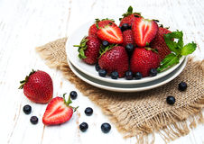 Plate with blueberries and strawberries Royalty Free Stock Images
