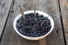 Plate of blueberries and three spoons. Blueberries is very good and healthy food Stock Photography