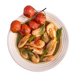 Plate of boiled shrimp with roasted tomatoes isolated Stock Photography