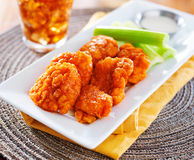 Plate of boneless buffalo flavored chicken wings Royalty Free Stock Images