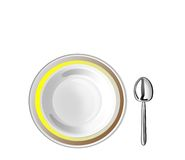 Plate with a border and spoon Royalty Free Stock Photos