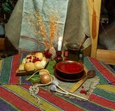 A plate of borscht with donuts. A plate of borscht with pampushky (donuts), traditional Great Lent holiday food, popular in Eastern Europe, on the table stock photo