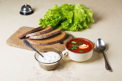 Plate of borscht with sour cream Stock Photos