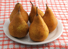 Plate with bosc pears Stock Photos