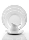 Plate and bowl. Set on white Stock Photography