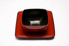 Plate and bowl. Bright red plate and bowl on a white background Stock Photography