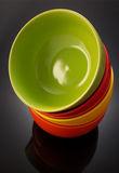 Plate and bowl on black Royalty Free Stock Photos