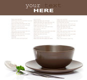 Plate, bowl, spoon and fork. With parsley isolated on white (with empty space Stock Images