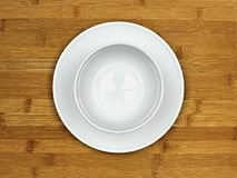 Plate and bowl on wood Stock Images