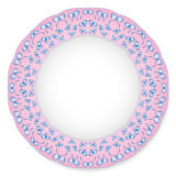 Plate with bows on a pink background Royalty Free Stock Images