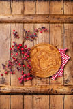 Plate and branch with red berries Royalty Free Stock Photos