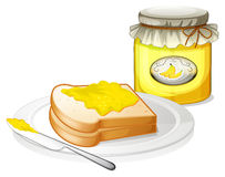 A plate with a bread and a jar of banana jam Stock Image