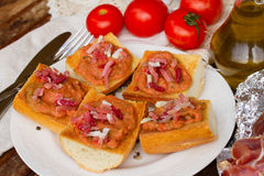 Plate of bread with tomatoes and jamon Stock Image