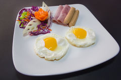 Plate of breakfast with fried eggs, bacon and toasts isolated ba Stock Photo